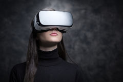 Girl wearing a VR headset Royalty Free Stock Images