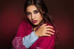 Girl is wearing warm colorful sweater and jewelry Stock Photography