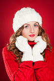 Girl wearing warm hat, mittens and red sweater Stock Photos