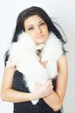 Girl wearing white fur Stock Images