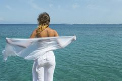 Girl wearing white scarf at the beach Royalty Free Stock Photos