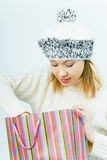 Girl wearing a winter cap. Winter Shopping Stock Images