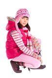 Girl wearing winter clothes Royalty Free Stock Photos