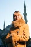 Girl wearing winter coat Stock Photos