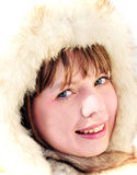 Girl wearing winter fur cap Royalty Free Stock Photos