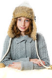 Girl wearing a winter hat. Pretty tween aged girl wearing a fuzzy winter hat shot in studio on a white background Stock Image