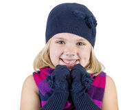 Girl wearing a winter hat scarf and mittens Royalty Free Stock Photography
