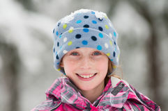 Girl wearing a winter hat Stock Photos