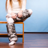 Girl wearing winter warm socks. Fashion, clothing, people concept. Girl wearing winter warm socks. Attractive young lady has white outfit and long hair Royalty Free Stock Photos