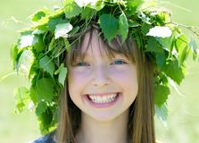 Girl wearing wreath. A portrait of a pretty girl wearing green wreath Royalty Free Stock Photos
