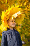 Girl wearing wreath of autumn leaves Stock Photo