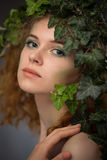 Girl wearing a wreath of ivy leaves. Beautiful girl wearing a wreath of ivy leaves Royalty Free Stock Photos
