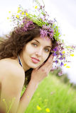 Girl wearing a wreath of wild flowers in the field Stock Images