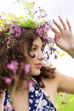 Girl wearing a wreath of wild flowers in the field Royalty Free Stock Photography