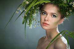 Girl wearing a wreath of wildflowers Stock Photos