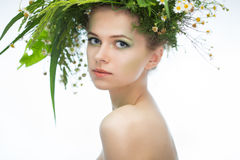 Girl wearing a wreath of wildflowers Royalty Free Stock Photo