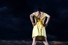 Girl wearing yellow dress Royalty Free Stock Photo