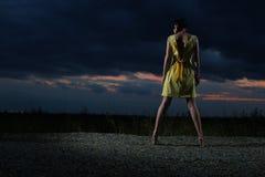 Girl wearing yellow dress Stock Photo