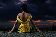 Girl wearing yellow dress Stock Photography