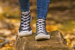 Girl wears with black sneakers Stock Image