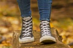 Girl wears with black sneakers walking on wood Stock Photo