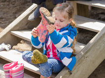 Girl wears boots sitting on the porch in the village Stock Images
