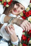 The girl wears a bracelet. Girl in a white hat Royalty Free Stock Photos