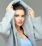 Girl wears large deep coat hood. Royalty Free Stock Image