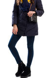 Girl wears navy down jacket. Stock Photos
