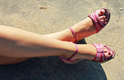 Girl Wears Pink Shoes at the Beach Royalty Free Stock Image