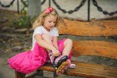 Girl wears roller skates. Royalty Free Stock Image
