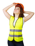 Girl wears a vest builder helmet on his head. Isolated. Stock Images