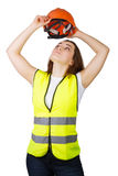 Girl wears a vest builder helmet on his head. Isolated. Royalty Free Stock Images