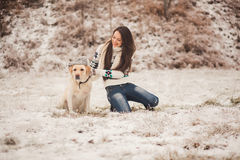 Girl wears a winter hat on the dog Stock Photos