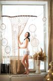The girl weaves macrame, catchers. Young woman hobby weaving. Dream catchers, macrame on the window. The girl weaves macrame, dream catchers. Young woman hobby stock photography