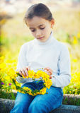 Girl weaves a wreath Royalty Free Stock Photography