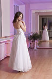Girl in wedding dress Stock Images