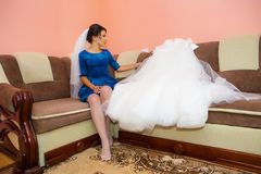 Girl with a wedding dress. Happy girl with a wedding dress Royalty Free Stock Photo