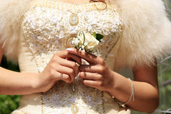 The girl in a wedding dress holding a small bouquet Royalty Free Stock Photo