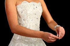 Girl in a wedding dress is looking at the ring royalty free stock photo