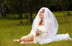 Girl in wedding dress in park Royalty Free Stock Photos