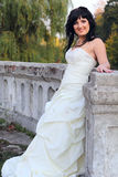 Girl in the wedding dress in the park Stock Images