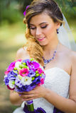 The girl in a wedding dress with purple bow Royalty Free Stock Photos