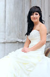 Girl in the wedding dress sitting Stock Photo