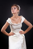 Girl in a wedding dress in the studio Royalty Free Stock Image