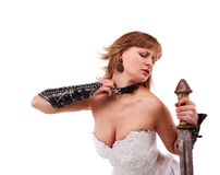 Girl in a wedding dress with a sword Stock Image