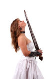Girl in a wedding dress with a sword Royalty Free Stock Photos