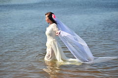 The girl in a wedding dress in water Stock Photo