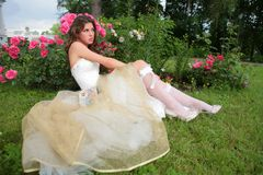 Girl in wedding gown Stock Images