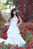 Girl in a weeding dress in a park Royalty Free Stock Images